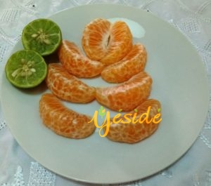 Tangerine fruit removed from the peel with lime
