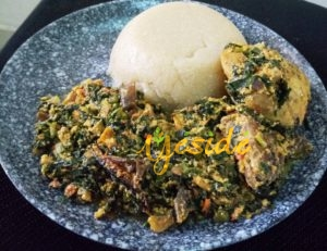 Eba made from white Gari with Egusi and Vegetables