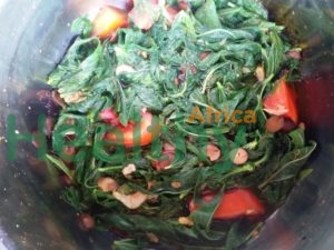 Ewedu, cooked with tomatoes, dried shrimps and locust beans